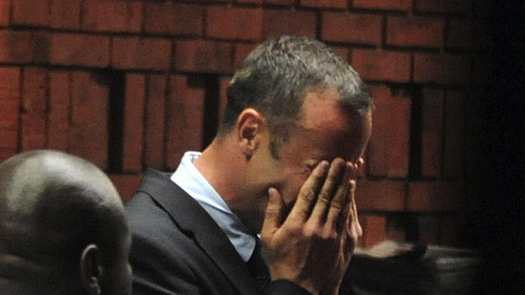 Paralympian star Oscar Pistorius was charged with murder after he allegedly shot and killed his girlfriend Reeva Steenkamp four times in his home in Pretoria, South Africa. The 'Blade Runner' broke down in tears as the charges was read out to him in court. He denies the allegations (Reuters)