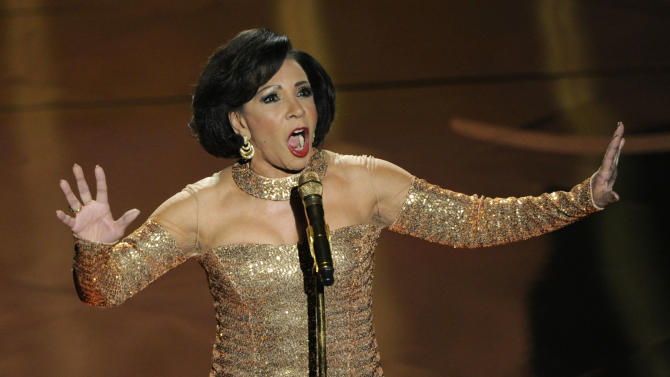 Singer Shirley Bassey performs during the Oscars at the Dolby Theatre on Sunday Feb. 24, 2013, in Los Angeles.  (Photo by Chris Pizzello/Invision/AP)