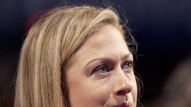 FILE - This Sept. 23, 2012 file photo shows Chelsea Clinton listening to her father, former President Bill Clinton speak during the Clinton Global Initiative, in New York. Former first daughter Chelsea Clinton has signed on to help promote President Barack Obama's inaugural kick-off event to get Americans across the country engaged in serving their communities. Inaugural planners announced Tuesday that Clinton will be honorary chair of the National Day of Service, the president's call for Americans to honor the legacy of Dr. Martin Luther King Jr. on the holiday weekend celebrating his birthday. (AP Photo/Mark Lennihan, File)