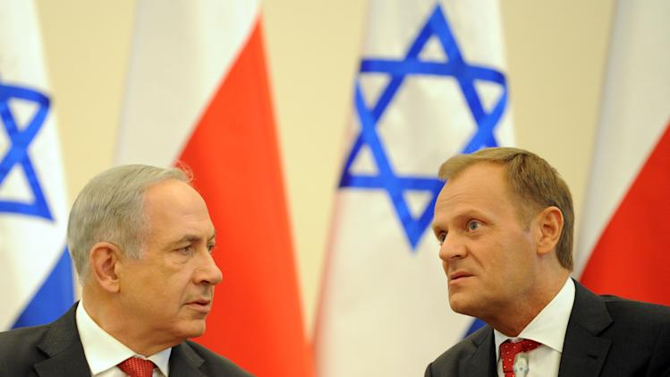 Israeli Prime Minister Benjamin Netanyahu, left, and his Polish counterpart Donald Tusk talk before a meeting with members of their governments in Warsaw, Poland, Wednesday, June 12, 2013. Netanyahu came to Poland for a two day visit for talks with Tusk and to attend the opening of a Holocaust exhibition in the former German Nazi Death Camp Auschwitz Birkenau. (AP Photo/Alik Keplicz)