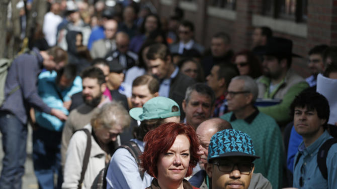 FILE - In this Thursday March 13, 2014, file photo, job seekers line up to attend a marijuana industry job far in Downtown Denver. The government issues the March jobs report on Friday, April 4, 2014. (AP Photo/Brennan Linsley, File)
