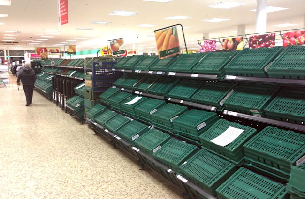 Bare: This was the scene at a Tesco in Cardiff as panic buying set in (SWNS)