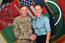 This July 13, 2011, photo made available on the International Security Assistance Force's Flickr website shows the former Commander of International Security Assistance Force and U.S. Forces-Afghanistan Gen. Davis Petraeus, left, shaking hands with Paula Broadwell, co-author of