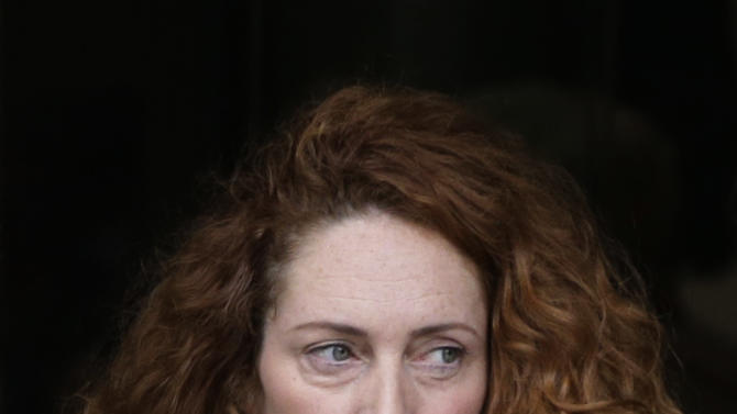 Rebekah Brooks, the former chief of News Corp.'s British operations, leaves the Old Bailey court in London London, Wednesday, Sept. 26, 2012. Rebekah Brooks and Andy Coulson, the ex-communications chief for Prime Minister David Cameron, learned Wednesday that they will face trial next September over allegations linked to phone hacking. (AP Photo/Lefteris Pitarakis)