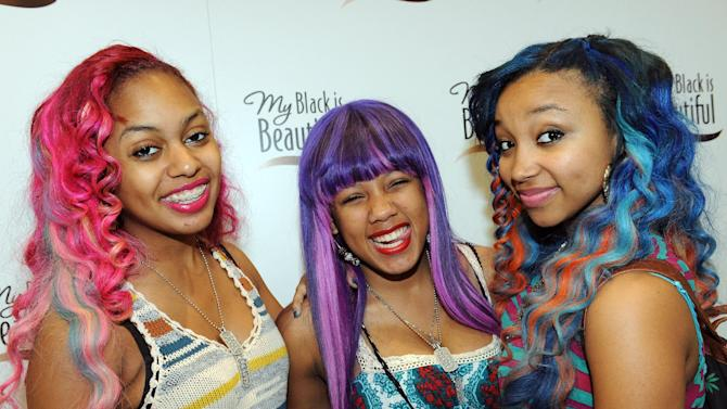 COMMERCIAL IMAGE - In this photograph taken by AP Images for P&G, pictured from left to right, the OMG Girlz pose for a photo at the My Black is Beautiful Experience at the Essence Music Festival in New Orleans, Saturday, July 7, 2012. (Cheryl Gerber/AP Images for P&G)