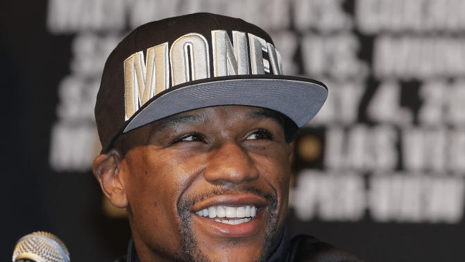 Boxer Floyd Mayweather Jr. reacts during a news conference, Wednesday, May 1, 2013, in Las Vegas. Mayweather will defend his WBCd welterweight title against Robert Guerrero on Saturday. (AP Photo/Julie Jacobson)