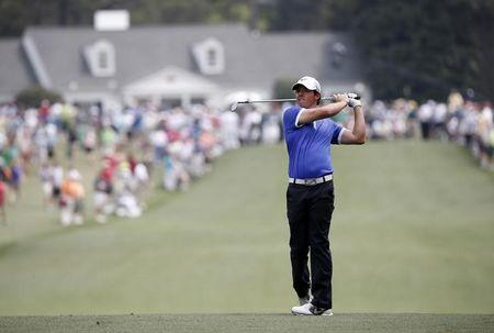 Rory McIlory of Northern Ireland hits his approach shot to the first green during first round play in the 2013 Masters golf tournament in Augusta