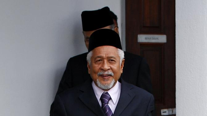 Malaysian-based National Revolution Front chief Hassan Taib leaves after the signing ceremony of the general consensus document to launch a dialogue process for peace in the border provinces of southern Thailand, in Kuala Lumpur, Malaysia, Thursday, Feb. 28, 2013. Thai authorities and Muslim militant leaders based in neighboring Malaysia agreed Thursday to hold talks to help ease nearly a decade of unrest in southern Thailand. (AP Photo/Lai Seng Sin)