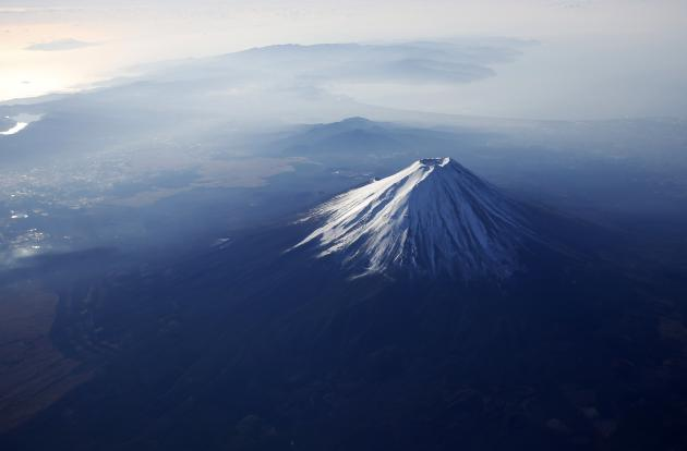 Japan's Mount Fuji is seen covered with snow from an airplane