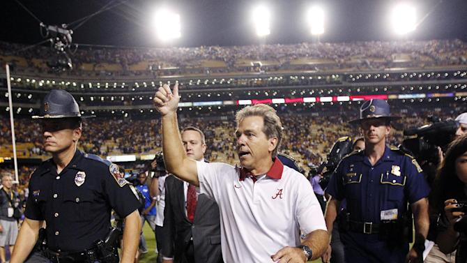 Alabama head coach Nick Saban acknowledges fans as he leaves the field after their 21-17 win in their NCAA college football game in Baton Rouge, La., Saturday, Nov. 3, 2012. (AP Photo/Gerald Herbert)