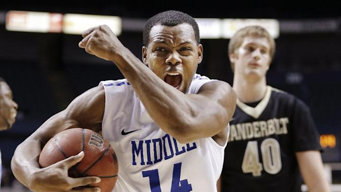 FILE - In this Dec. 21, 2012, file photo, Middle Tennessee guard Marcos Knight (14) celebrates after drawing a foul in the final seconds of an NCAA college basketball game against Vanderbilt in Nashville, Tenn. In a season of parity that has produced quite a few surprises, a few of the unexpected turns, such as Middle Tennessee's success, have stood out. (AP Photo/Mark Humphrey, File)
