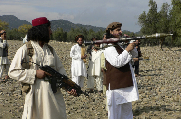 Pakistani Taliban chief Hakimullah Mehsud, right, holds a rocket launcher with his comrades in Sararogha of Pakistani tribal area of South Waziristan along the Afghanistan border. Pakistan's leading militants have called on fighters to honor an agreement not to attack the Pakistani military in the most important sanctuary for the Taliban and al-Qaida along the Afghan border.