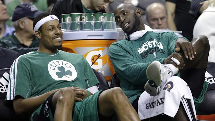 FILE - Boston Celtics center Kevin Garnett, right, chats with teammate Paul Pierce on the bench during the fourth quarter of an NBA basketball game against the Toronto Raptors in Boston, in this March 13, 2013 file photo. The Brooklyn Nets will acquire Paul Pierce and Kevin Garnett from the Boston Celtics in a deal that was still developing as the NBA draft ended, according to a person with knowledge of the details. The trade can't be completed until July 10, after next season's salary cap is set, so pieces were still being discussed early Friday June 28, 2013. (AP Photo/Elise Amendola, File)