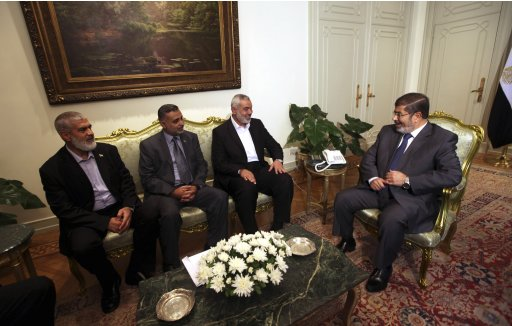 Egypt's president Mohamed  Mursi meets with Senior Hamas leader Ismail Haniya at the presidential palace in Cairo