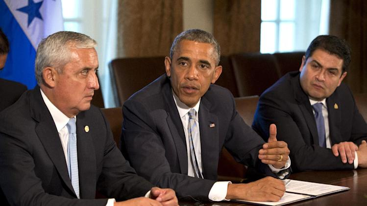 Guatemala's President Otto Perez Molina, left, and Honduran President Juan Hernandez, right, listen as U.S. President Barack Obama speaks to the media, after they met to discuss Central American immigration and the border crisis in the Cabinet Room of the White House Friday, July 25, 2014, in Washington. (AP Photo)