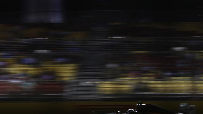 Mercedes Formula One driver Rosberg speeds through a straight during the second practice session of the Singapore F1 Grand Prix