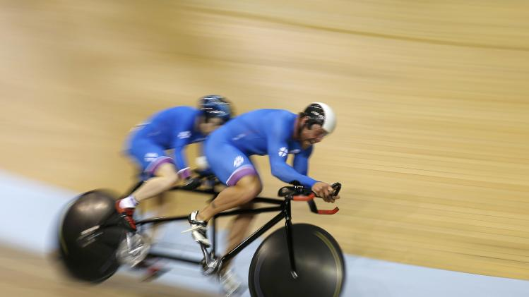 Scotland's Neil Fachie and Craig MacLean compete in the men's 1000m Time Trial B2 Tandem cycling race at the 2014 Commonwealth Games in Glasgow