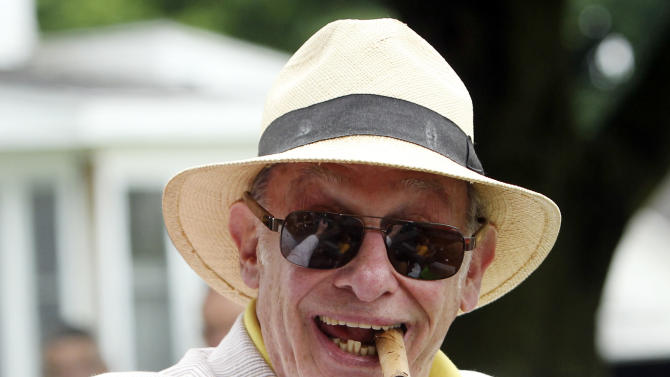 In this file photo taken June 12, 2011, boxing historian Bert Sugar is seen during the Boxing Hall of Fame parade in Canastota, N.Y. Sugar, known for his fedora and cigar, has died. Jennifer Frawley, Sugar's daughter, said cardiac arrest caused his death on Sunday, March 25, 2012. His wife, Suzanne, was by his side when he passed away. (AP Photo/Mike Groll, File)
