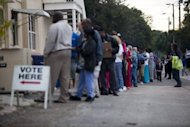 Lines of voters wait to cast their ballots as the polls open on November 6, in St. Petersburg, Florida. US President Barack Obama&#39;s top aide in Florida said Democrats have won the vote in the officially undeclared Sunshine State, where officials are under fire for mishandling the ballot