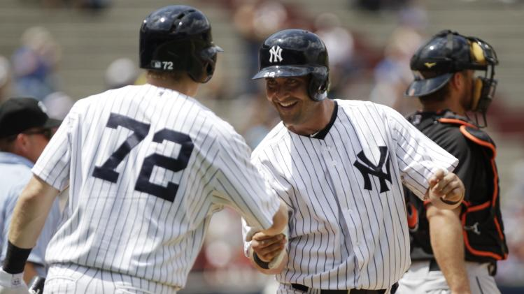 "New York Yankees' Cervelli shakes hands with teammate Joseph after scoring run against Miami Marlins during second inning of the exhibition game ""Legend Series"" honoring former New York Yankees player Mariano Rivera, at the Rod Carew Stadium in Panama City"