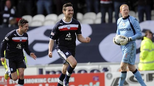 Dundee's Carl Finnigan, centre, celebrated returning from injury by getting on the scoresheet