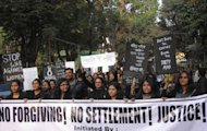 Indian youths hold placards as they take part in protest following the gang rape of a student last week in the Indian capital during a rally in Siliguri on December 22, 2012