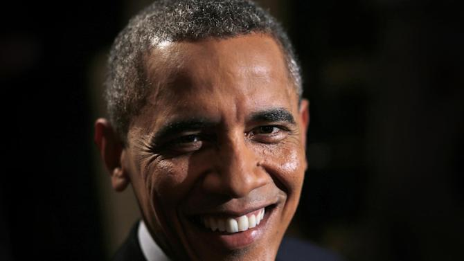 """In this photo taken Friday, Oct. 4, 2013, President Barack Obama poses for a photo prior to an exclusive interview with The Associated Press in the White House library in Washington four days into a partial shutdown of the government. Obama, who successfully ran for president as a first-term senator, spoke critically about first-term Republican senators, such as Ted Cruz of Texas, who have been leading efforts to shut the government if Republicans can't extract concessions from the White House. He said that when he was in the Senate, he """"didn't go around courting the media. And I certainly didn't go around trying to shut down the government."""" (AP Photo/Charles Dharapak)"""