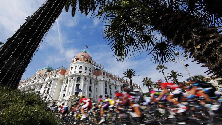 The pack of the riders cycles after the start of the eighth and final stage of Paris-Nice cycling race in Nice