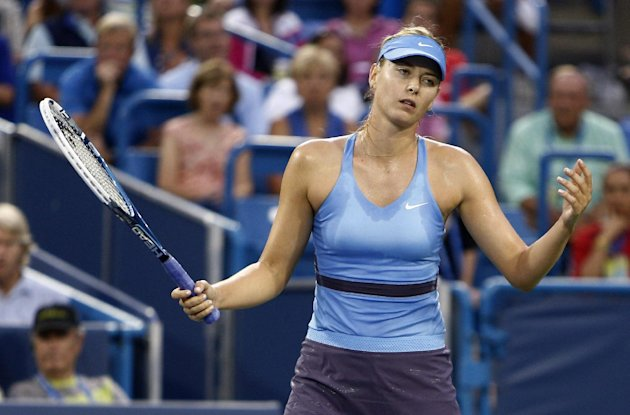 Maria Sharapova, from Russia, reacts in a semifinal against Ana Ivanovic, from Serbia, at the Western & Southern Open tennis tournament, Saturday, Aug...