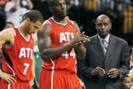 Atlanta Hawks coach Larry Drew, right, stands with players Jannero Pargo (7) and Ivan Johnson (44) during a timeout in the fourth quarter in Game 4 of an NBA basketball first-round playoff series against the Boston Celtics, in Boston on Sunday, May 6, 2012. The Celtics won 101-79. (AP Photo/Michael Dwyer)