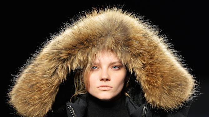 A model walks the runway for the Rudsak Fall 2015 collection during Toronto fashion week in Toronto on Thursday, March 26, 2015. (AP Photo/The Canadian Press, Nathan Denette)
