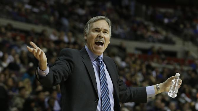 Los Angeles Lakers head coach Mike D'Antoni gestures during the first quarter of an NBA basketball game against the Detroit Pistons at the Palace of Auburn Hills, Mich., Sunday, Feb. 3, 2013. (AP Photo/Carlos Osorio)