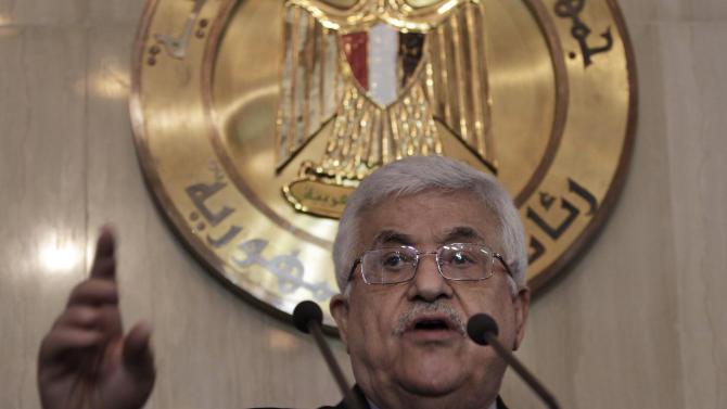 Palestinian President Mahmoud Abbas speaks at a news conference following his meeting with Egyptian President Mohammed Morsi, unseen, at the presidential palace in Cairo, Egypt, Wednesday, July 18, 2012.(AP Photo/Maya Alleruzzo)