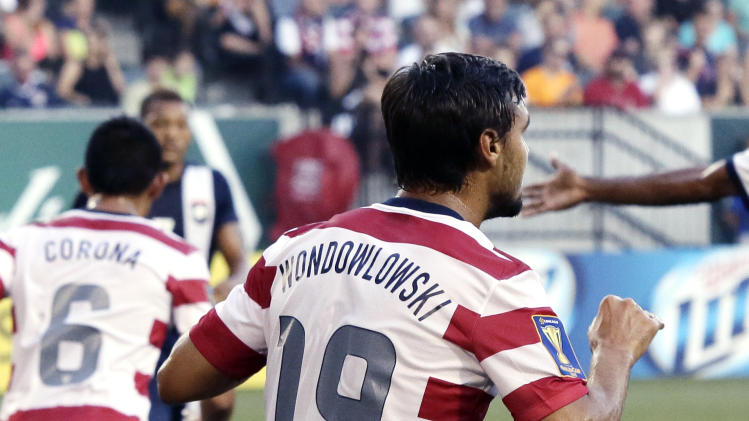 United States' Chris Wondolowski wears a jersey with his name misspelled during the first half of their CONCACAF Gold Cup soccer game against Belize in Portland, Ore., Tuesday, July 9, 2013. Wondolowski changed to a properly spelled jersey for the second half of the game they won 6-1.(AP Photo/Don Ryan)