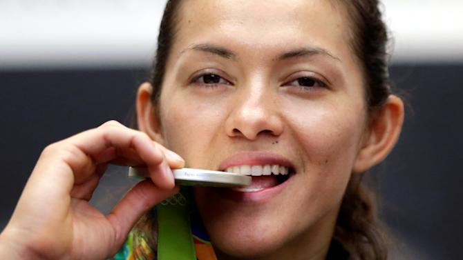 Maria del Rosario Espinoza, taekwondo Olympic silver medallist, poses with her medal during a news conference after her return from the 2016 Rio Olympics at the international airport in Mexico City