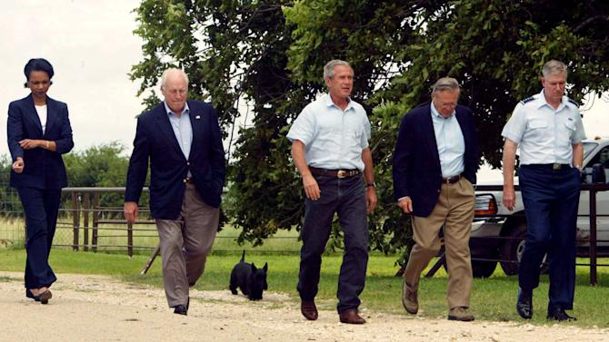 FILE - In this Aug. 23, 2004 file photo, President Goerge W. Bush, center, walks out with, from left to right, National Security Adviser Condoleezza Rice, Vice President Dick Cheney, Secretary of Defense Donald Rumsfeld, and Joint Chiefs Chairman Richard Myers followed by Bush's dog Barney, after their meeting on Bush's ranch Monday, Aug. 23, 2004, in Crawford, Texas. Barney, former White House Scottish Terrier and star of holiday videos shot during President George W. Bush's administration, has died after suffering from cancer, the former president announced in a statement Friday, Feb. 1, 2013. He was 12.  (AP Photo/Pablo Martinez Monsivais, File)
