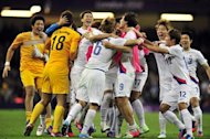 South Korea's midfielder Sungyueng Ki celebrates scoring the winning penalty after extra time during the London 2012 Olympic Games men's quarter-final football match between Great Britain and South Korea at the Millennium Stadium in Cardiff, Wales on August 4, 2012.  AFP PHOTO / GLYN KIRK