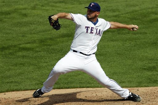 Rangers win 9-7 over A's for split, 4-game lead