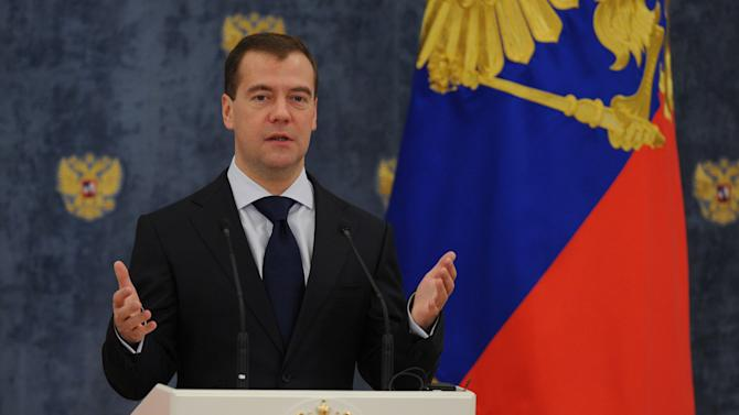 Russian President Dmitry Medvedev speaks at  an award ceremony in the Gorki residence outside Moscow, Tuesday, Nov. 22, 2011. Medvedev presented Russian medals to IOC President Jacques Rogge and International Ice Hockey Federation President Rene Fazel. (AP Photo/Alexander Nemenov, Pool)