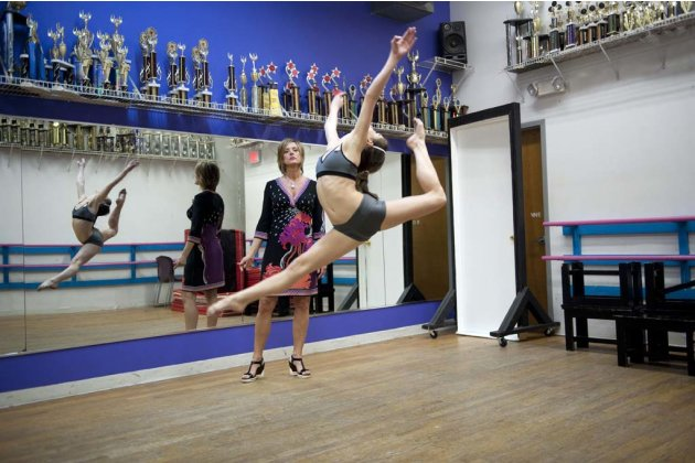 "Kelly watches her daughter Brooke glide through the air in ""Dance Moms."""