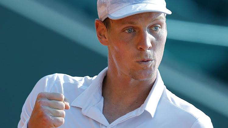 Tomas Berdych of Czech Republic reacts during his match of the Monte Carlo Tennis Masters tournament in Monaco against Marcel Granollers of Spain, Wednesday, April 17, 2013. (AP Photo/Lionel Cironneau)