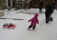 A child pulls her doll on a snow sledge in the Kosovo capital, Pristina on Tuesday, Dec. 11, 2012. Weather forecasts predict cold temperatures and snow for Eastern Europe during the upcoming days. (AP Photo/Visar Kryeziu )