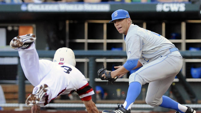 UCLA pitcher Nick Vander Tuig right, prepares to tag out North Carolina State's Jake Armstrong at home plate on a single by Trea Turner in the third inning of an NCAA College World Series baseball game in Omaha, Neb., Tuesday, June 18, 2013. (AP Photo/Eric Francis)