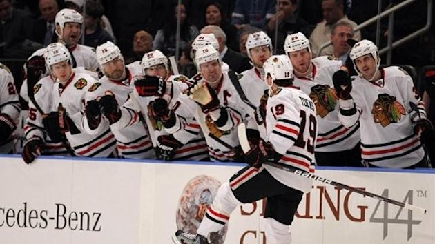 Jonathan Toews celebrates with his Chicago Blackhawks team-mates