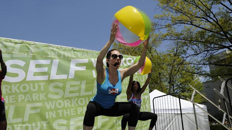 Nicola Haire leads a Beach Body workout during SELF Magazine's Workout on the Quad event at American University, Saturday, April 27, 2013, in Washington. This special on campus event was held in celebration of the 20th annual Workout in the Park outdoor fitness festival from SELF Magazine. (Nick Wass/AP Images for SELF Magazine)