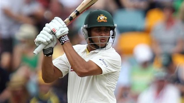 CRICKET Australia's Usman Khawaja cuts a ball during their first test cricket match against New Zealand at the Gabba in Brisbane December 2, 2011.