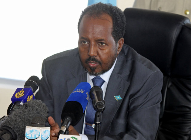 Somalia's new president Hassan Sheikh Mohamud speaks at a press conference shortly before two explosions occurred near the gate of his temporary home at the Jazeera Hotel in Mogadishu, Somalia, Wednesday, Sept. 12, 2012. A day after the election of Somalia's new president, two explosions at the gate of his temporary residence killed at least five people and wounded three others Wednesday, witnesses and officials said. (AP Photo/Farah Abdi Warsameh)