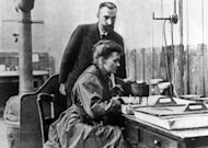 An undated picture showing Marie Curie-Skolodowska with Pierre Curie, working in their laboratory in Paris. The Curies helped rip aside the veil hiding radioactivity, even coining the term for it. They discovered two new elements, polonium and radium, and made artificial radioactivity from stable elements such as boron and magnesium