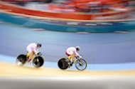 China's Gong Jinjie and Guo Shuang compete to set a new world record of the Women's team sprint during the qualifying rounds as part of the track cycling event of London 2012 Olympic games, at the ExCel centre in London. Germany were crowned Olympic women's team sprint champions in controversial fashion following the relegation of event winners China here Thursday