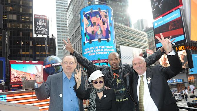 """Yoko Ono Lennon, second left, joined by Hard Rock International President & CEO Hamish Dodds, right, WhyHunger Founder Bill Ayres, left, and Darryl  """"DMC"""" McDaniels attend the launch of Hard Rock's fifth annual IMAGINE THERE'S NO HUNGER campaign, Monday, Nov. 19, 2012, in New York's TImes Square. Proceeds from the campaign benefit WhyHunger and its grassroots partners combating childhood hunger and poverty worldwide. (Diane Bondareff/Invision for Hard Rock International/AP Images)"""